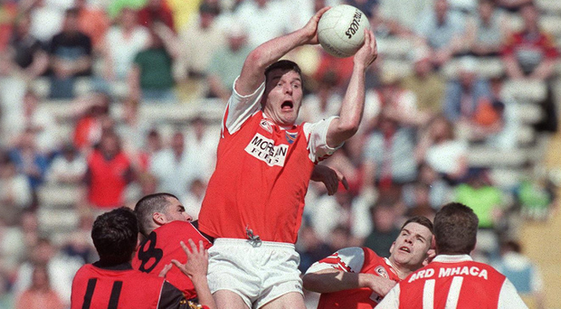 New role: Jarlath Burns, in action during his Armagh hey-day, is Chairman of the Football Review Committee