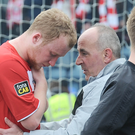 Final blow: Tommy Breslin consoles Liam Boyce after the 2013 decider. Photo: Stephen Hamilton/ Presseye