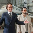 Bryan Cranston as Robert Mazur/Bob Musella and John Leguizamo as Emir Abreu. Picture credit: PA Photo/Warner Home Video
