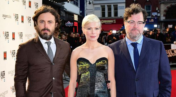 Critics' choice: Manchester By The Sea stars Casey Affleck and Michelle Williams with director Kenneth Lonergan. Picture credit: Ian West/PA Photos