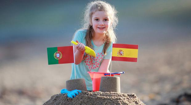Flagging up holiday opportunities in Spain and Portugal, always top of the pops with Northern Irish holiday-makers, is five-year-old Caitie McNirlan from Comber. Both countries will be strongly represented at Belfast Telegraph Holiday World, joined this year by an Algarve showcase, highlighting the holidays in Portugal's southernmost region, known for its fabulous beaches, golf resorts and great wine and food and accessible by direct flights from Belfast.