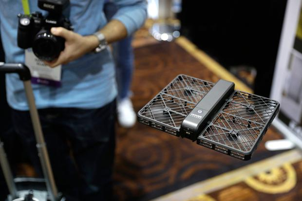 The Hover Camera Passport flies during CES Unveiled before CES International, Tuesday, Jan. 3, 2017, in Las Vegas. (AP Photo/John Locher)