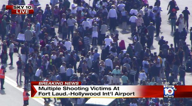 In this still image from video provided by NBC TV Local10, people stand on the tarmac after shots were fired at the international airport in Fort Lauderdale, Fla., Friday, Jan. 6, 2017. Local10 and other news media outlets reported Friday that multiple people were shot. (NBC TV Local10 via AP)