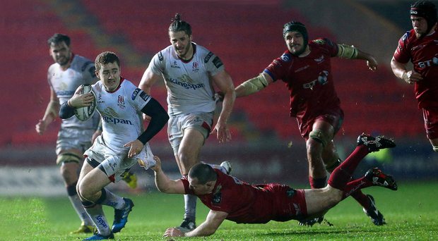 On the charge: Ulster's Paddy Jackson evades Ken Owens of Scarlets in Llanelli