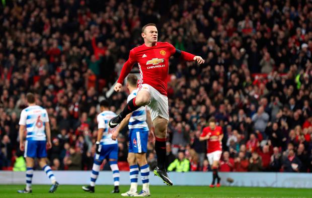 Manchester United's Wayne Rooney celebrates scoring his side's first goal to equal Sir Bobby Charlton's all-time scoring record for Manchester United by scoring his 249th goal for the club during the Emirates FA Cup, Third Round match at Old Trafford, Manchester. PA