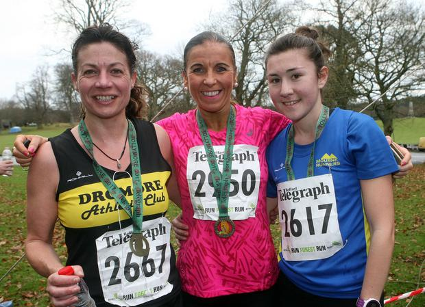 Belfast Telegraph Run Forest Run Tollymore 10k winners: Gillian Burns 2nd, Cathy McCourt 1st and Bethany Haugh 3rd. Photo: Freddie Parkinson/Press Eye.