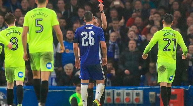 Chelsea's John Terry receives a red card for a foul during the Emirates FA Cup, Third Round match at Stamford Bridge, London. Adam Davy/PA Wire.
