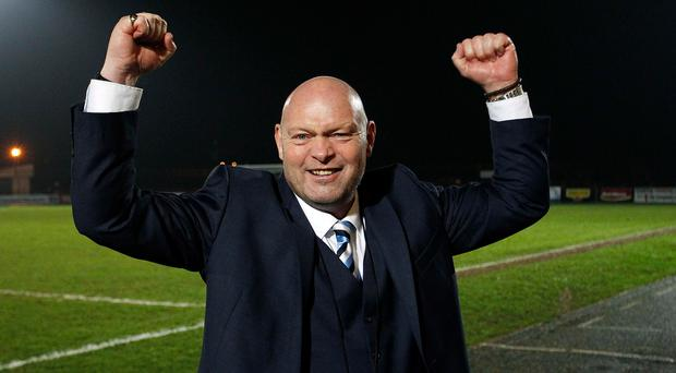 On the spot: Ballymena boss David Jeffrey salutes the fans at the Showgrounds after his side's win over Cliftonville on penalties