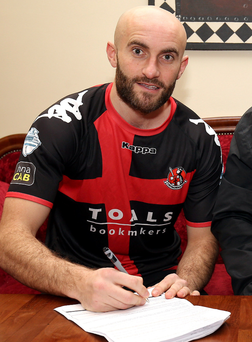 Sign here: Crusaders new boy Alan Keane joins the Seaview ranks