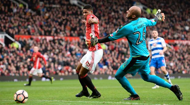Big blunder: Marcus Rashford takes full advantage of Ali Al-Habsi's error to get his second goal in the 4-0 win over Reading