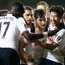 Centre of attention: Ben Davies is mobbed after his opener