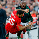 Close encounter: Kevin Stewart of Liverpool battles with Plymouth's Paul Arnold Garita during their 0-0 draw at Anfield