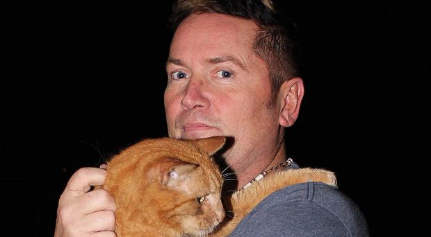 Cat Tom with new owner Dave