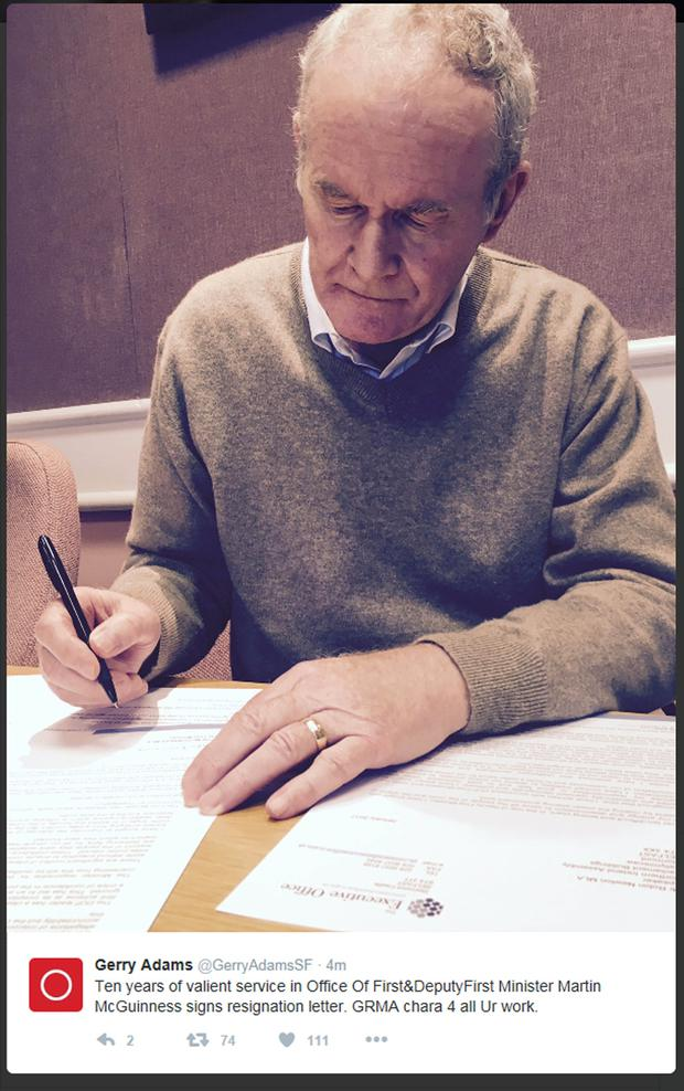 Martin McGuinness signs resignation letter.