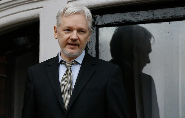 FILE - In this Feb. 5, 2016 file photo, WikiLeaks founder Julian Assange speaks from the balcony of the Ecuadorean Embassy in London. (AP Photo/Kirsty Wigglesworth, File)