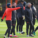 Laughing matter: Man United boss Jose Mourinho and players at training yesterday