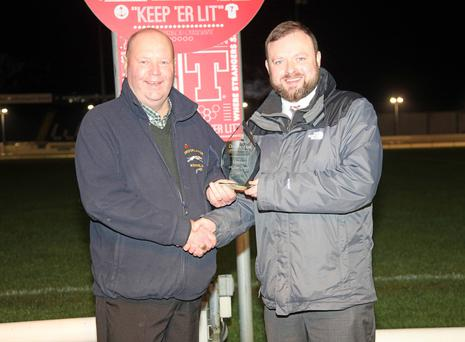 Winner: John Shaw accepts the Owner of the Year trophy from Drumbo Park racing manager John Connor
