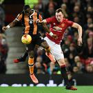 Hull City's Norwegian striker Adama Diomande (L) vies with Manchester United's English defender Phil Jones during the EFL (English Football League) Cup semi-final football match between Manchester United and Hull City at Old Trafford in Manchester, north west England on January 10, 2017. AFP/Getty Images