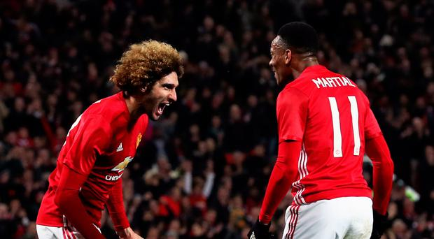 Manchester United's Marouane Fellaini celebrates scoring his side's second goal of the game during the EFL Cup Semi Final, First Leg match at Old Trafford, Manchester. PA