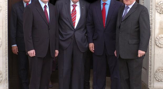 Bertie Ahern (right) with (from left) former Secretary of State Peter Hain, Martin McGuinness, Ian Paisley, Tony Blair and leave Stormont after the first day of the Northern Ireland Assembly in May 2007