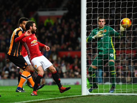 Finishing touch: Juan Mata opens the scoring during the EFL Cup semi-final first leg battle with Hull City