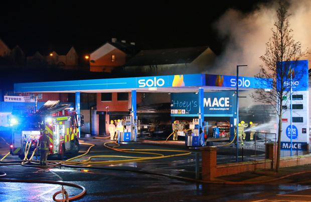 Firefighters battle a major blaze at Hoey's Mace in West Belfast on 11th January 2017 (Photo - Kevin Scott / Belfast Telegraph)