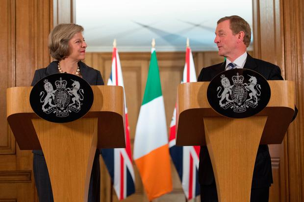 File photo dated 26/07/16 of Prime Minister Theresa May and Irish Taoiseach Enda Kenny, who have pledged to work together to find a way through the political crisis that has threatened devolution in Northern Ireland. PA