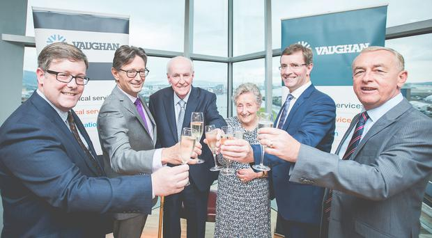 Toasting £30m of new orders: Bryan Vaughan, Director; Mike Vaughan, Group Managing Director; Albert Vaughan, Chairman; Mrs Isabel Vaughan; Gavin Vaughan, Group Finance Director and Garry Black, Managing Director.