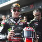 Rivals in shade: Jonathan Rea celebrates last year's victory at Phillip Island, his favourite venue