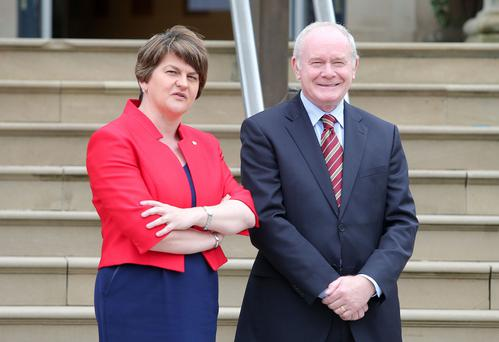 Outgoing First Minister Arlene Foster with ex-Deputy First Minister Martin McGuinness