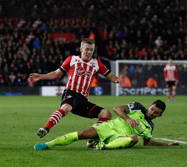 Crucial touch: Liverpool's Dejan Lovren (right) challenges James Ward-Prowse