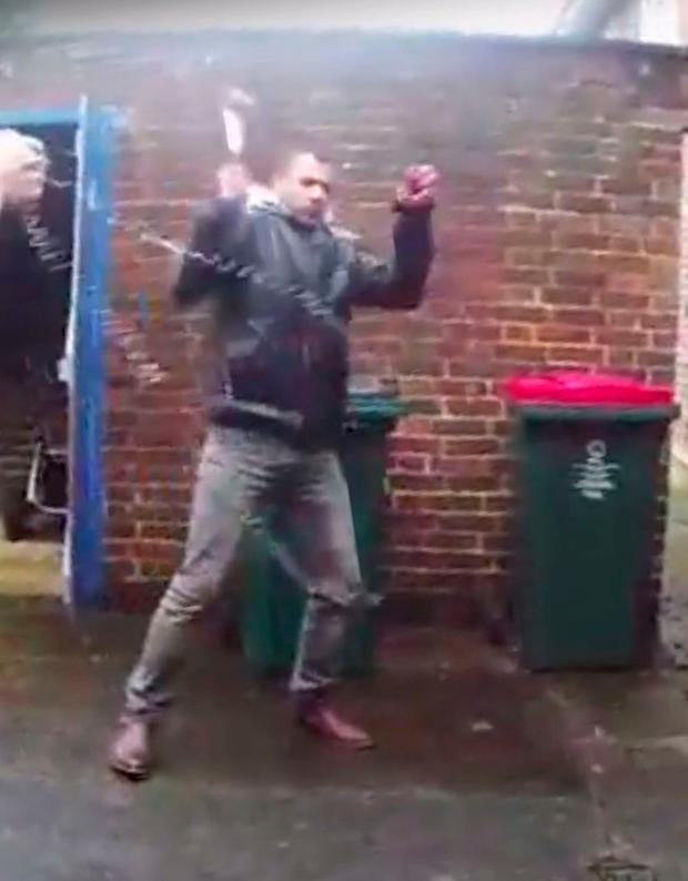 Still from a body worn video camera issued by Sussex Police of Jamshid Piruz attacking two officers with a hammer in Crawley last year and who has been jailed for life for the attack. PA
