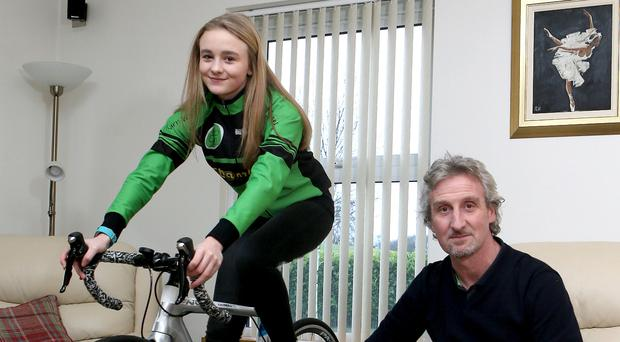 Like father like daughter: Tyco BMW boss Philip Neill with daughter Katie (13) who is enjoying success in cycling and mountain biking