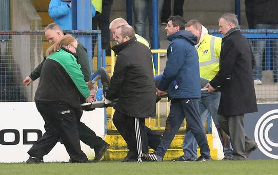 Pacemaker Belfast 14-1-17 Coleraine's Eoin Bradley is stretchered off after colliding with the post during today's game at Coleraine Showgrounds, Coleraine. Photo by David Maginnis/Pacemaker Press