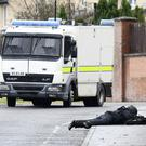 PACEMAKER BELFAST 15/01/2017 Police and ATO at the scene of a security alert in the Brians Well Road area of west Belfast on Sunday Morning. ATO are conducting searches and the road has been closed. Photo Colm Lenaghan/Pacemaker Press