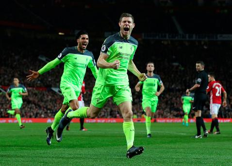 Liverpool's James Milner celebrates scoring his side's first goal from the penalty spot during the Premier League match at Old Trafford, Manchester. PRESS ASSOCIATION Photo. Picture date: Sunday January 15, 2017. See PA story SOCCER Man Utd. Photo credit should read: Martin Rickett/PA Wire. RESTRICTIONS: EDITORIAL USE ONLY No use with unauthorised audio, video, data, fixture lists, club/league logos or