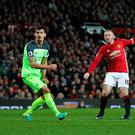 Manchester United's Wayne Rooney (right) has a shot on goal during the Premier League match at Old Trafford, Manchester. PRESS ASSOCIATION Photo. Picture date: Sunday January 15, 2017. See PA story SOCCER Man Utd. Photo credit should read: Martin Rickett/PA Wire. RESTRICTIONS: EDITORIAL USE ONLY No use with unauthorised audio, video, data, fixture lists, club/league logos or