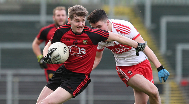 Edging home: Down's Shay Millar shields the ball during the narrow win over Derry at Pairc Esler yesterday