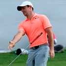 Thrown away: Rory McIlroy reacts after missing a putt on the 3rd play off hole at the South African Open yesterday