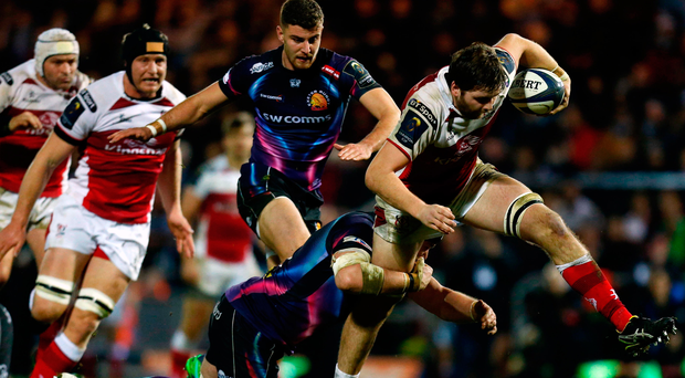 On a charge: Iain Henderson attempts to break through against Exeter