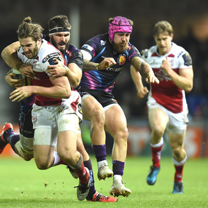 Running man: Ulster's Stuart McCloskey is tackled by Exeter's Don Armand at Sandy Park last night