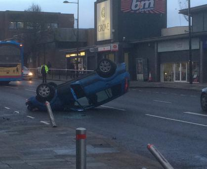 Car overturns on Market Street. Pic: McCartan Sports