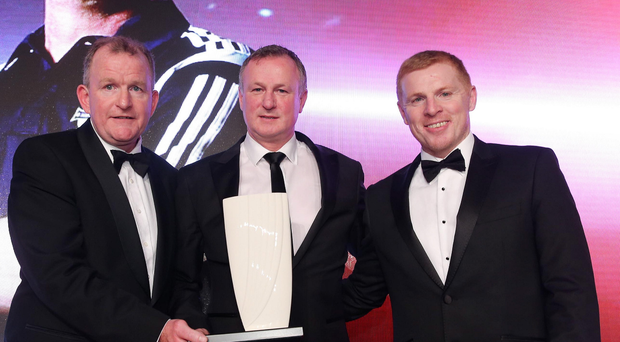 Tops: Michael O'Neill (centre) is awarded our 2015 Manager of the Year prize fromINM (NI) Managing Director Richard McClean and former Celtic manager Neil Lennon