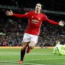 Familiar sight: Zlatan Ibrahimovic hails his strike against Liverpool, his 14th goal in 20 Premier League matches