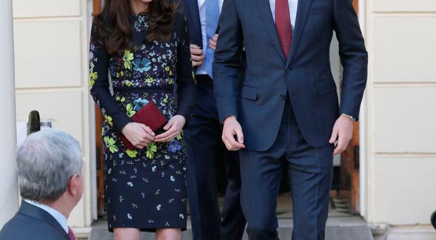 The Duke and Duchess of Cambridge and Prince Harry leaving the Institute of Contemporary Art in London yesterday