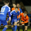Jostle: Ballinamallard's Ryan McConnell darts away from Glenavon midfielder Mark Sykes