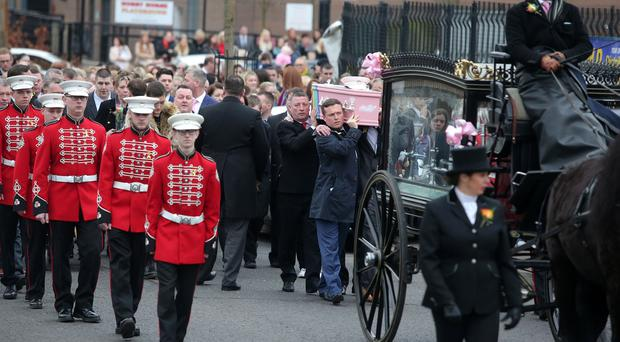Funeral for eight-year-old Dempsey Ballantyne who died following a battle with cancer. Dempsey's coffin is carried from City Life Church on Northumberland Street in west Belfast after a thanks giving service. The coffin is flanked by members of Shankill Star Flute Band of which she was a member. Picture by Jonathan Porter/PressEye.com