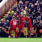 Liverpool's Lucas Leiva (centre) celebrates scoring his side's first goal of the game during the Emirates FA Cup, third round replay match at Home Park, Plymouth. PA