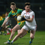 On the ball: Tyrone ace Ronan O'Neill gets away from Eoghan Ban Gallagher of Donegal