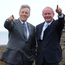 Former First Minister Peter Robinson and former deputy First Minister Martin McGuinness wave to the visitors during the opening of the New Visitors centre at the Giants Causeway in Co Antrim. Pacemaker Press 3/7/2012. Photo: Colm Lenaghan/ Pacemaker